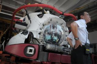 Ships and planes looking for MH370- A Submarine Rescue Vehicle on board the MV Swift Rescue, a private submarine rescue vessel contracted to the Republic of Singapore Navy.