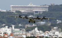 Ships and planes looking for MH370-File photo- C-130 Hercules transport plane -AP Photo-Greg Baker, File
