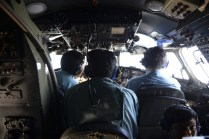 Vietnamese Air Force officers sit in the cockpit of a search and rescue aircraft as they fly over the search area for a missing Malaysia Airlines plane March 9, 2014. — Reuters pic