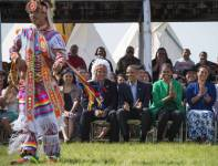 Barack Obama and first lady Michelle Obama sit with Chairman of the Standing Rock Sioux Tribal Nation David Archambault II (3rd from left) and his wife, Nicole (right), during the Cannon Ball Flag Day Celebration in North Dakota.
