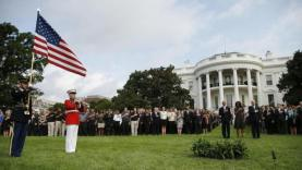 U.S. President Obama, U.S. first lady Michelle and Vice President Biden observe a moment of silence on the 13th anniversary of the 9/11 attacks at the White House in Washington