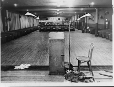 Crime Scene Photo. The Audubon Ballroom stage after the assassination. Malcolm X was standing at the podium in the background addressing a rally when he was shot.All three gunmen were convicted in March 1966 and sentenced to life in prison.Credit: Stanley Wolfson/Library of Congress