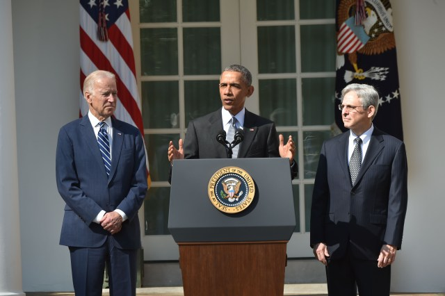 US President Barack Obama, with Vice President Joe Biden (L), announces his Supreme Court nominee, Merrick Garland (R), in the Rose Garden at the White House in Washington, DC, on March 16, 2016. Garland, 63, is currently Chief Judge of the United States Court of Appeals for the District of Columbia Circuit. The nomination sets the stage for an election-year showdown with Republicans who have made it clear they have no intention of holding hearings to vet any Supreme Court nominee put forward by the president. / AFP / Nicholas Kamm        (Photo credit should read NICHOLAS KAMM/AFP/Getty Images)