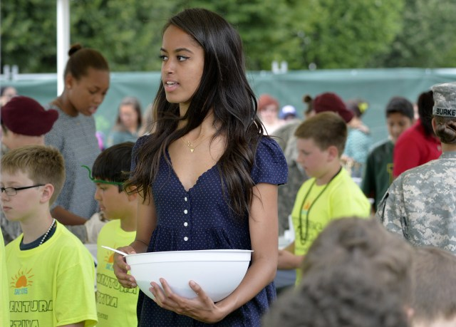 Malia Obama, daughter of US President serves food during a lunch at the United States and Nato military base in Vicenza  on June 19, 2015 .   AFP PHOTO / ANDREAS SOLARO        (Photo credit should read ANDREAS SOLARO/AFP/Getty Images)