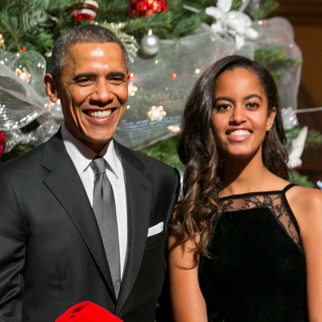 """WASHINGTON, DC - DECEMBER 14: (AFP OUT) U.S. President Barack Obama (C, R), first lady Michelle Obama (L) and daughters Sasha (C,L) and Malia (R) pose with """"elves"""" prior to the taping of TNT's """"Christmas in Washington"""" program on December 14, 2014 in Washington, DC. The """"elves"""" are former patients of Children's National Medical Center, the beneficiary of this evenings concert. (Photo by Kristoffer Tripplaar-Pool/Getty Images)"""