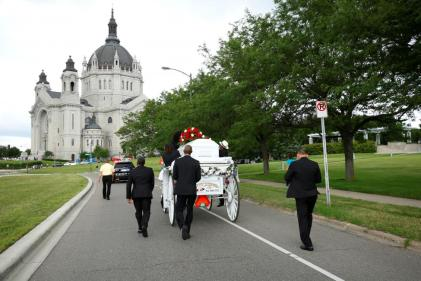 The funeral procession for Philando Castile travels from the Brooks funeral home to the St Paul Cathedral in St Paul, Minnesota, July 14, 2016. REUTERS/Adam Bettcher
