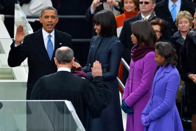 WASHINGTON, DC - January, 21: President Barack Obama takes the oath of office from Supreme Court Chief Justice John Roberts as First Lady Michelle Obama and daughters Malia Obama and Sasha Obama look on during the 57th Presidential Inauguration Ceremony at the United States Capitol on Monday, January 21, 2013.  President Barack Obama was sworn in for his second term of office. (Photo by Ricky Carioti/The Washington Post)