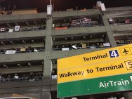 Protesting from the parking garage.. People with legal visas detained at JFK Airport