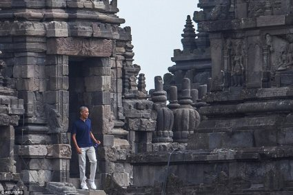 Barack Obama, wearing light trousers, trainers, a blue polo shirt and holding a bottle of water, leaves the Hindu temple Read more: http://www.dailymail.co.uk/news/article-4649902/Obama-waves-performs-traditional-Hindi-greeting.html#ixzz4lYHrgbnx Follow us: @MailOnline on Twitter | DailyMail on Facebook