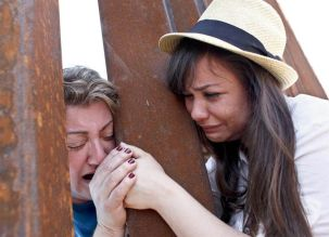 UMass Boston student Renata Teodoro, right, and her mother, Gorete Borges Teodoro, who was deported in 2007, met at a U.S.-Mexico border fence. (Courtesy Samantha Sais, via The New York Times)