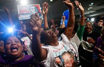 Obama supporters Mary Decker, center, Annete Davis, left, and others celebrate as the Democrat's presidential win is announced in Birmingham, Ala., on Nov. 4 Mario Tama / Getty
