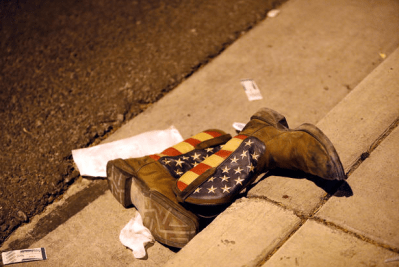 A pair of cowboy boots is seen in the street outside the concert venue after the mass shooting on the Las Vegas Strip. They belonged to concertgoer Stephen Vicelja, who was shot in the leg and said a bystander helped him take off the boots to bandage the wound. CREDIT: REUTERS/Las Vegas Sun/Steve Marcus