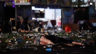 People are seen on the ground after gunman opened fire on concert goers