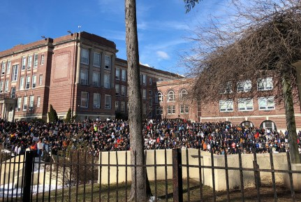 Students fill the grounds outside Montclair High School, 12 miles from midtown Manhattan, during a walkout one month after 17 Florida students were shot dead, in Montclair, New Jersey, U.S. March 14, 2018. REUTERS/Bernadette Baum - RC1181C045C0