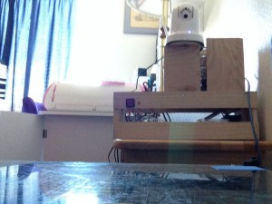 View of the camera (top, just right of center) from the bed of the 3D printer.