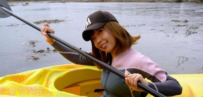Igarashi paddling in her vagina shaped kayak