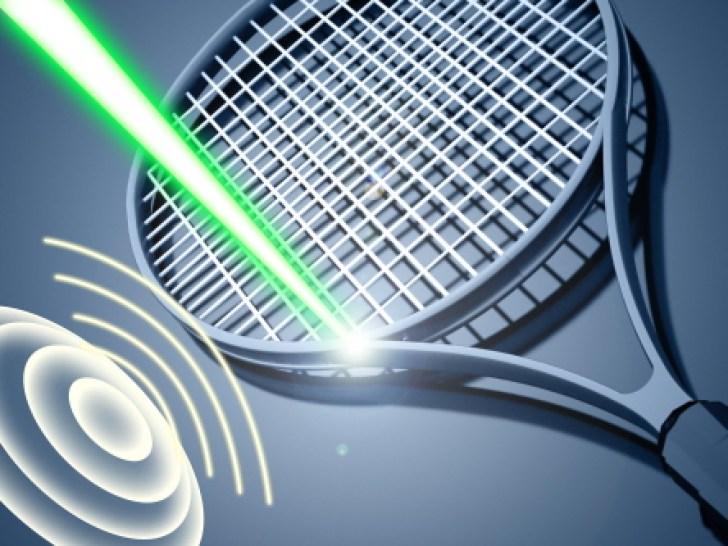Tennis racket on blue