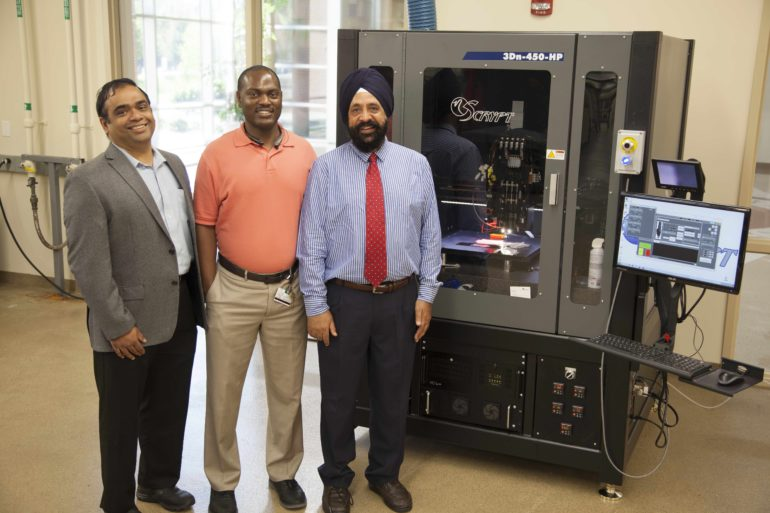 From FAMU News Professors Ramakrishnan, Dickens and Sachdeva (left to right) in front of the high-resolution 3D printer that will be used to manufacture novel materials and devices.