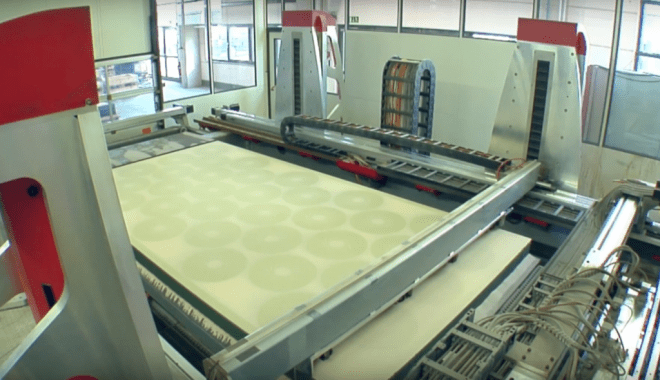 voxeljet's large format 3D printer manufacturing sand casting molds. Photo via voxeljet.