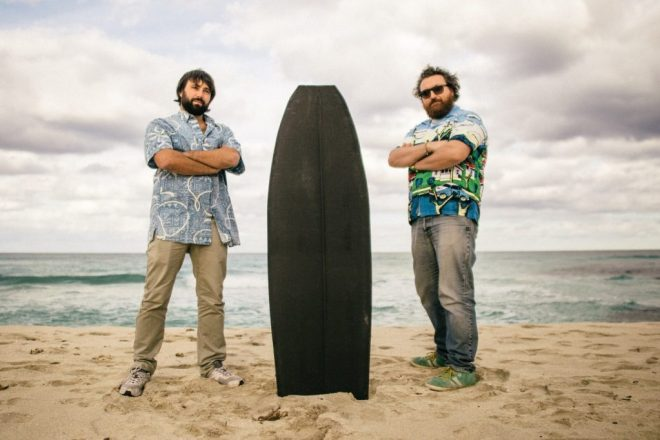 Francesco Belvisi (left) and Daniele Cevola (right) founders of OCORE and a surfboard 3D printed using their proprietary technology. Photo via OCORE