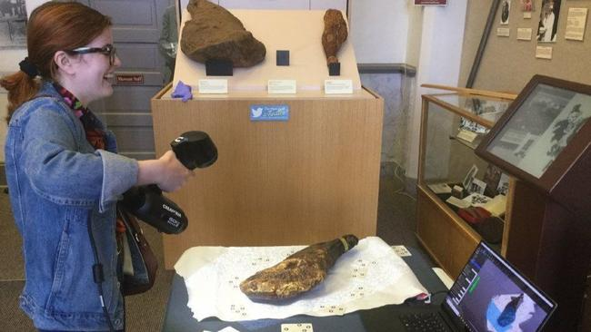 Virginia Commonwealth University student Rebecca McGovern scans the Smithfield ham in the Isle of Wight County Museum Thursday. Photo via Daily Press/Courtesy of Bernard Means.