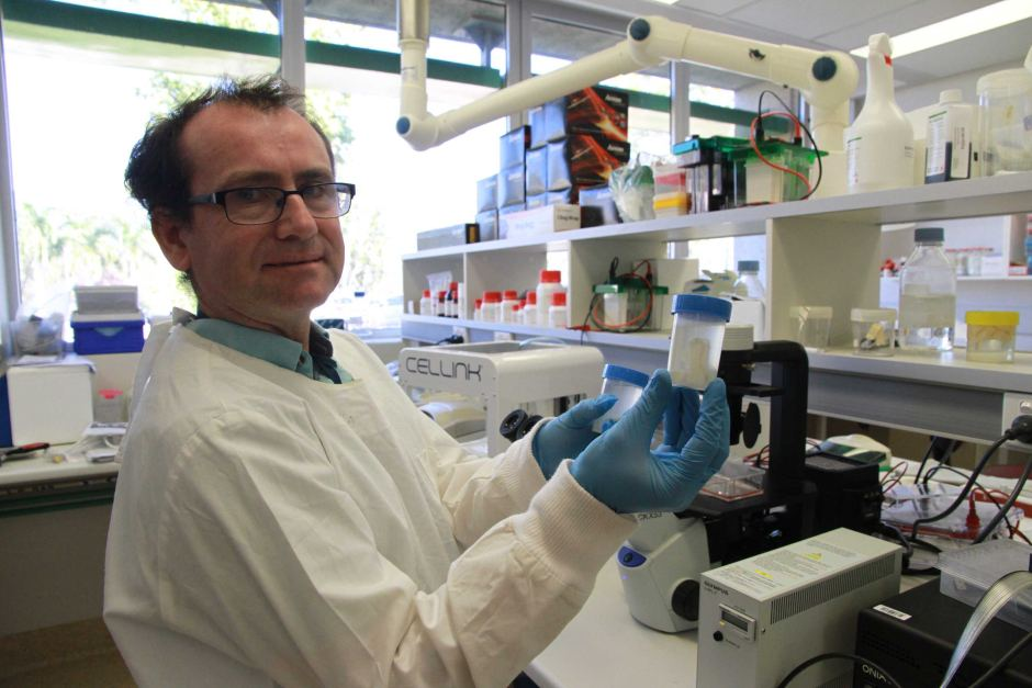 Microbiologist Dr Padraig Strappe with a croc cartilage. Photo via ABC News