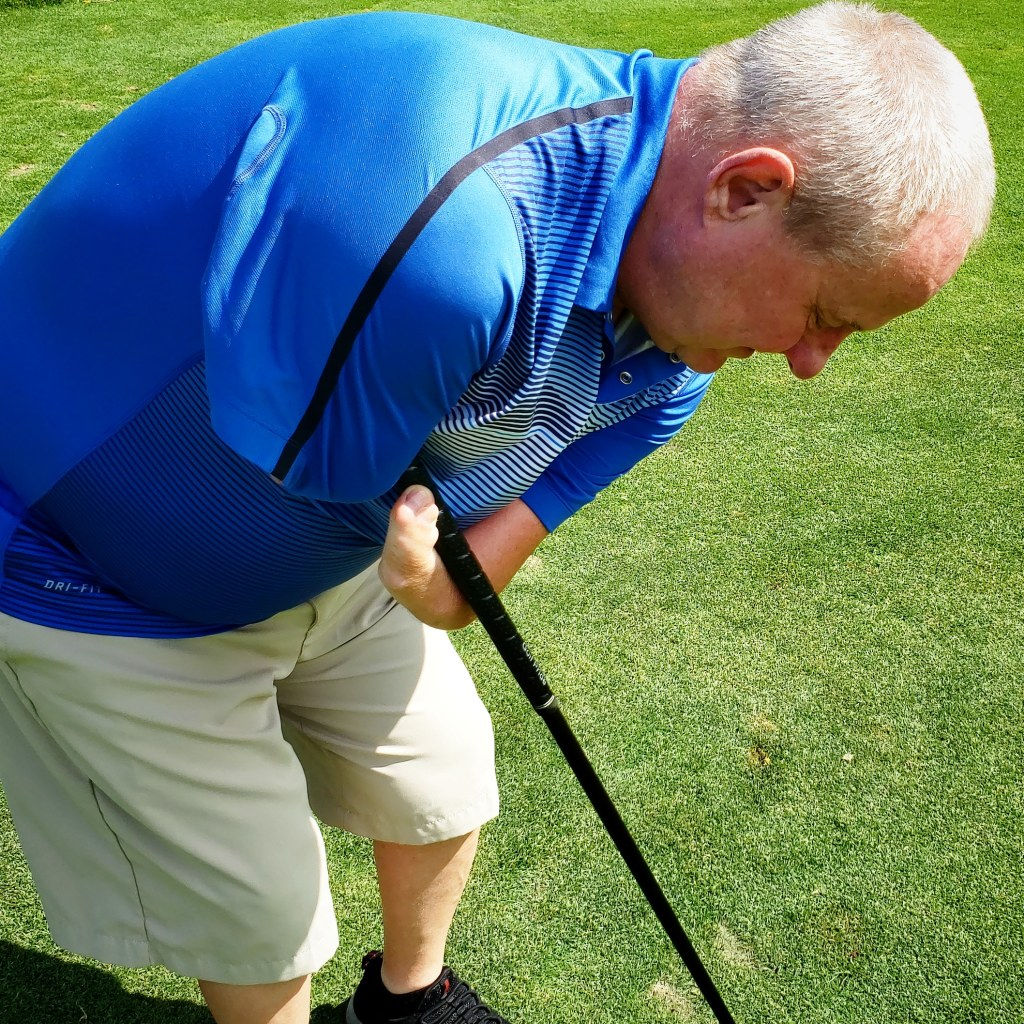 Terrafilum President, Chris Jackson, showing how he holds a golf club with a limb difference