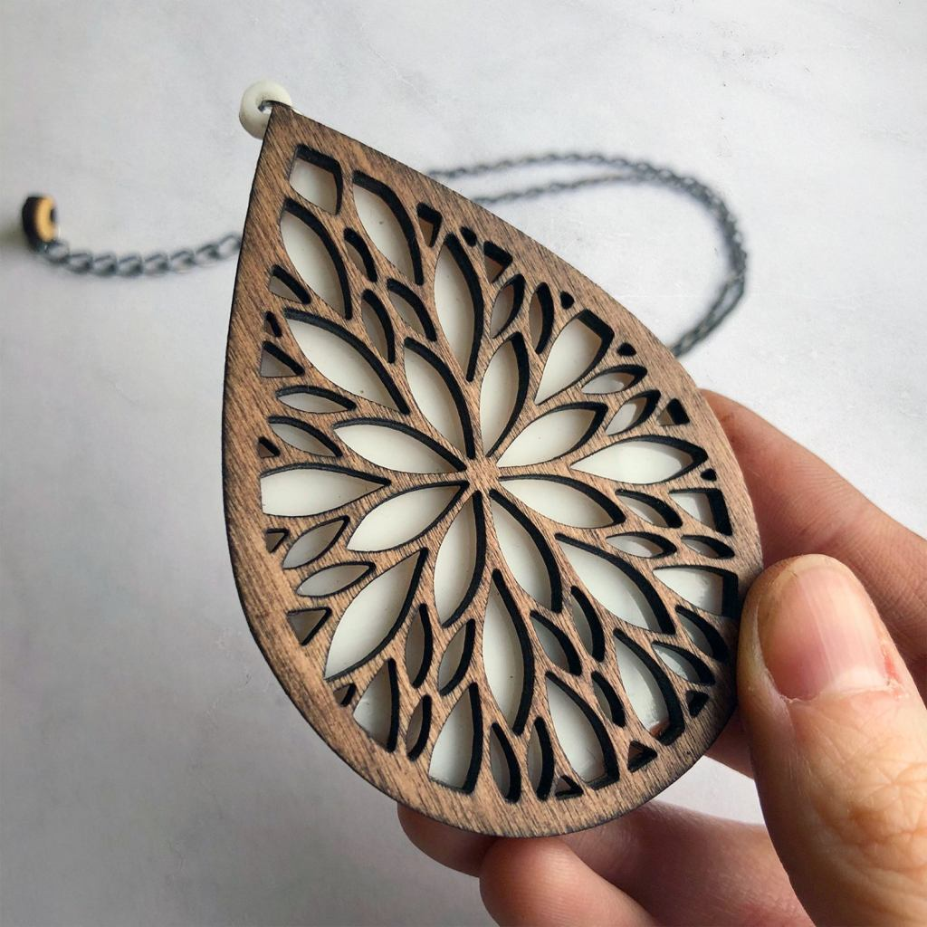 A large laser cut wood pendant