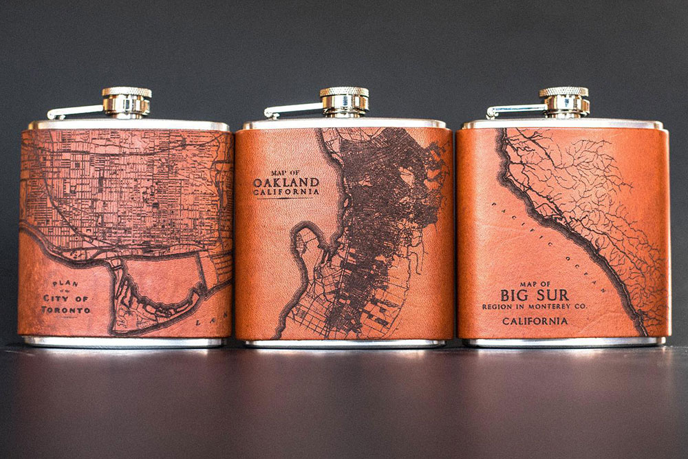 Laser etched and cut flasks from Tactile Craftworks