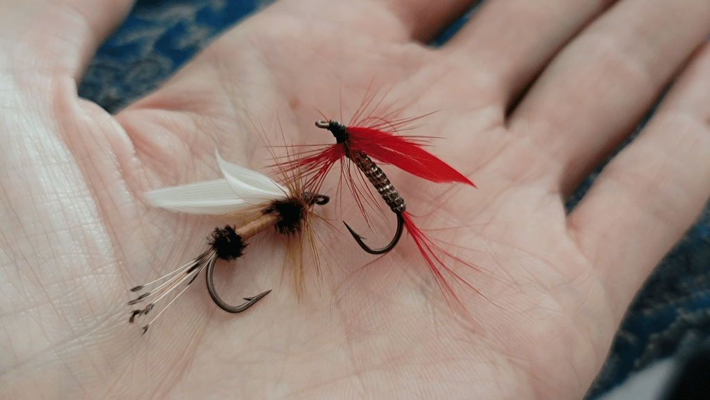 Fly fishing tied flies in a hand