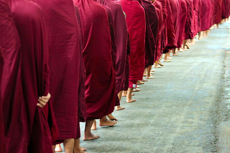 Monks walk inline in Amarapura, Myanmar. Anti-Muslim sentiment remains high among certain Buddhist enclaves in Myanmar. Source: KX Studio's flickr photostream, used under a creative commons license.