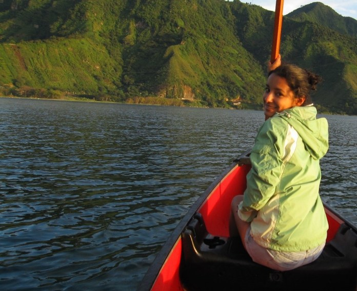Africa Flores in a canoe