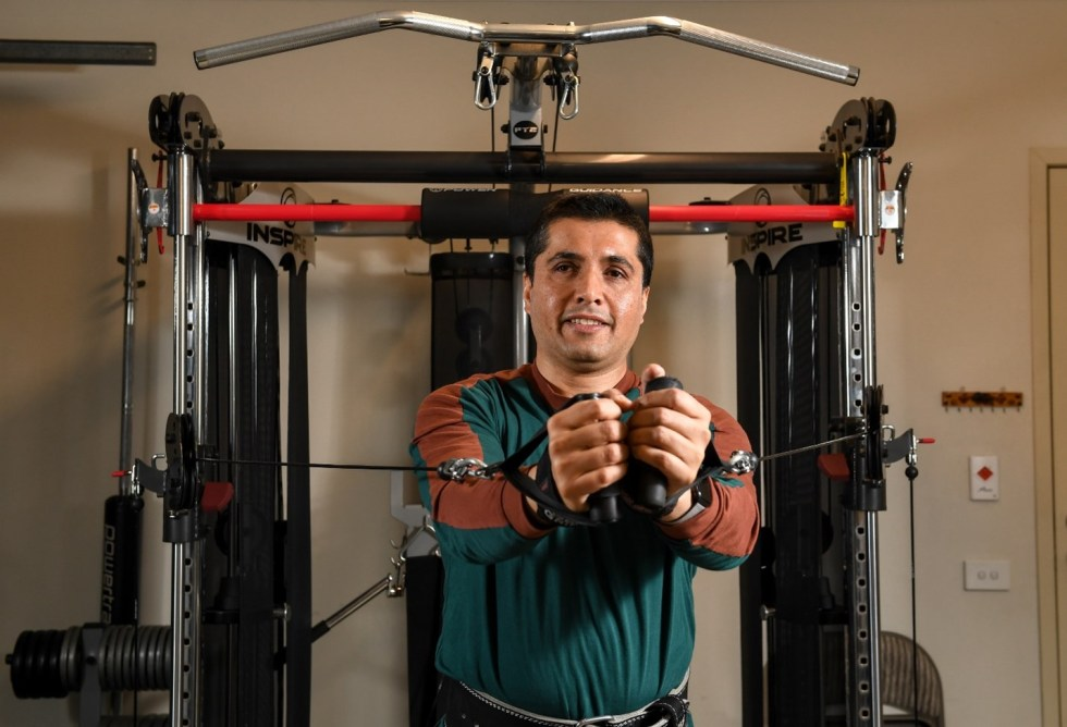 Man on a exercise machine in a gym