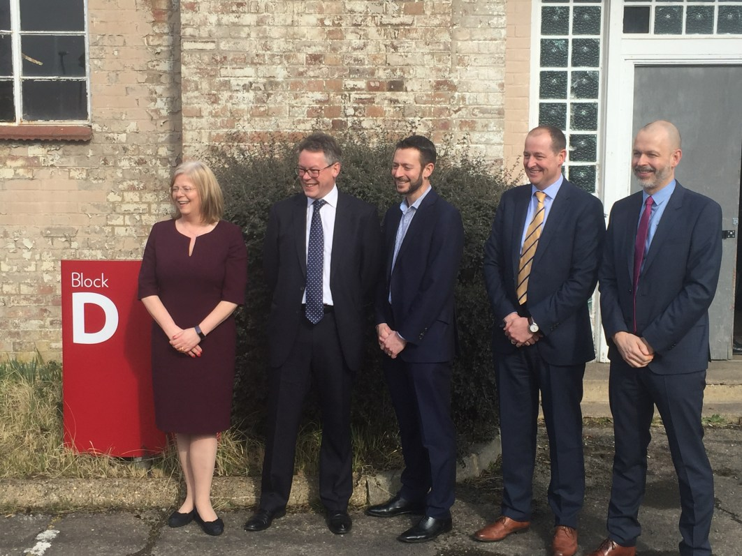 Derrick McCourt (right) from Microsoft joins other members of the consortium and Sir John Dermot Turing outside D Block at Bletchley Park