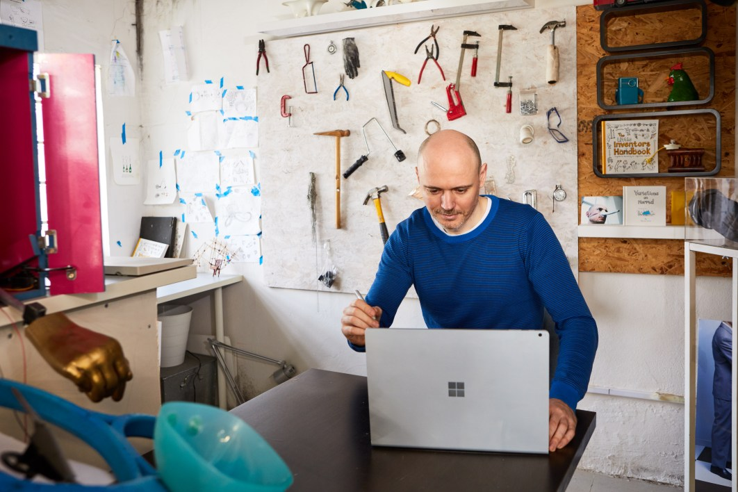 Dominic Wilcox, inventor, works on a Surface Book 2 in his London studio