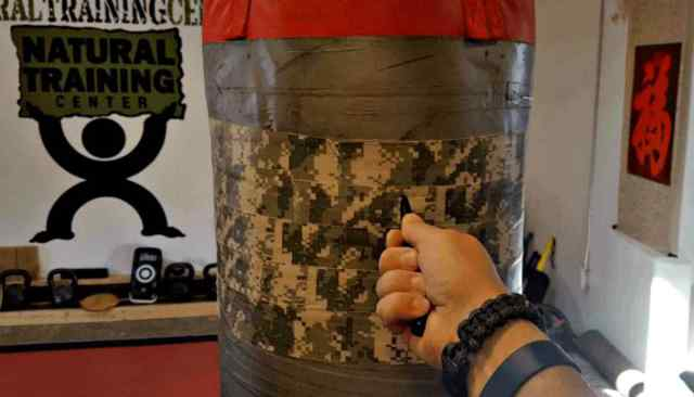 """Punch bag and a pen 