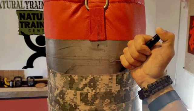 """Punchbag using write something using pens   Tactical Pens: They """"Ain't"""" Just For Writing"""