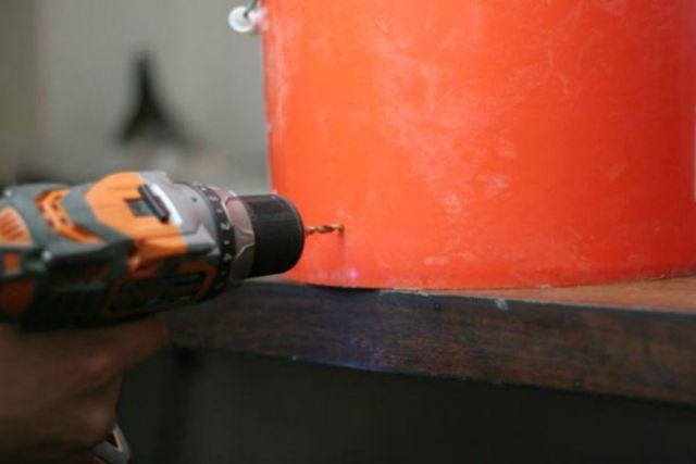 Drill hole in the bucket | How To Make A Moonshine Still