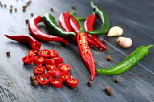 Hot Peppers on Wooden Table