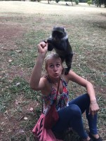 Carly playing with a monkey!