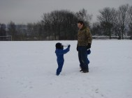 Throwing snowballs at Daddy!