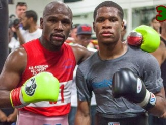 Floyd Mayweather (left) with Devin Haney in training gear