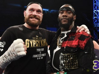 Tyson Fury poses with Deontay Wilder at Windsor Park