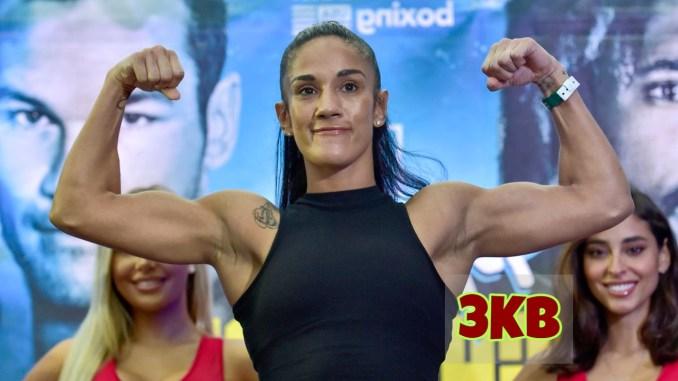 Amanda Serrano flexes her muscles.