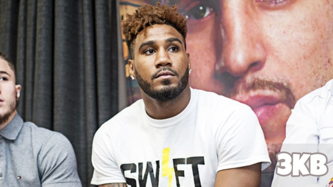 Jarrett Hurd listens to a question from the media