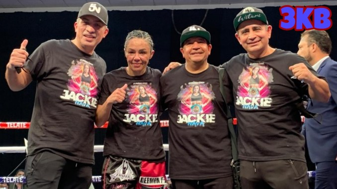 Jackie Nava poses in the ring with her team