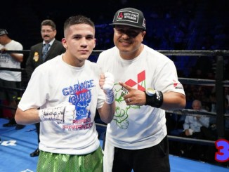 Jesse Rodriguez poses in the ring with trainer Robert Garcia
