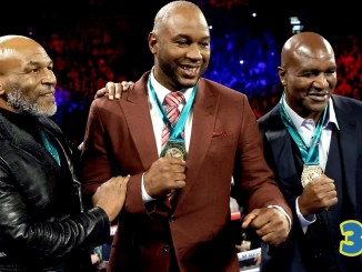 Mike Tyson, Lennox Lewis and Evander Holyfield being honored in the ring