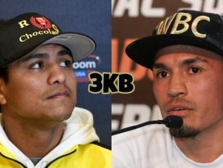 Roman Gonzalez looking up, WBC super flyweight champion Juan Francisco Estrada speaks into a microphone