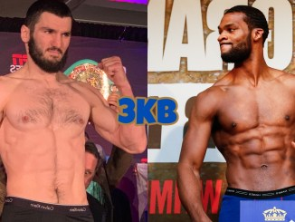 Unified light heavyweight champion Artur Beterbiev poses for the press, Marcus Browne looking to the left during a weigh-in